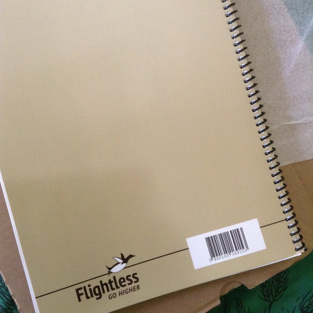 Back of book showing Flightless logo