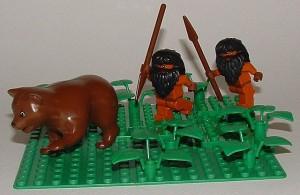 LEGO cavemen chasing a bear