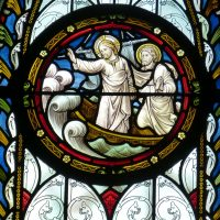 Stained glass showing Jesus calming the storm. A clear sign of God's Reassuring Love.