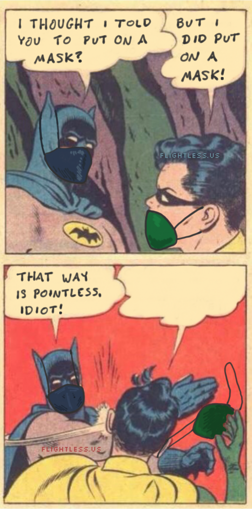Batman slaps Robin for failing to wear a face mask correctly.